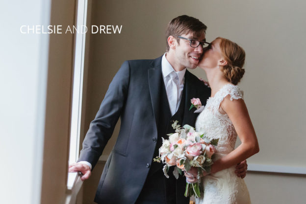 bride kisses groom in church
