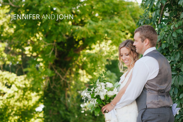 bride and groom huging on a farm