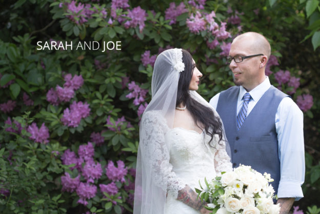 wedding couple surrounded by beautiful purple flowering trees