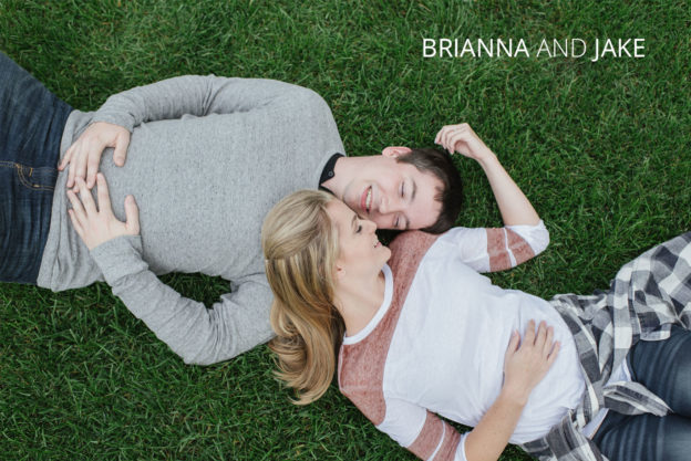 in love couple laying in grass