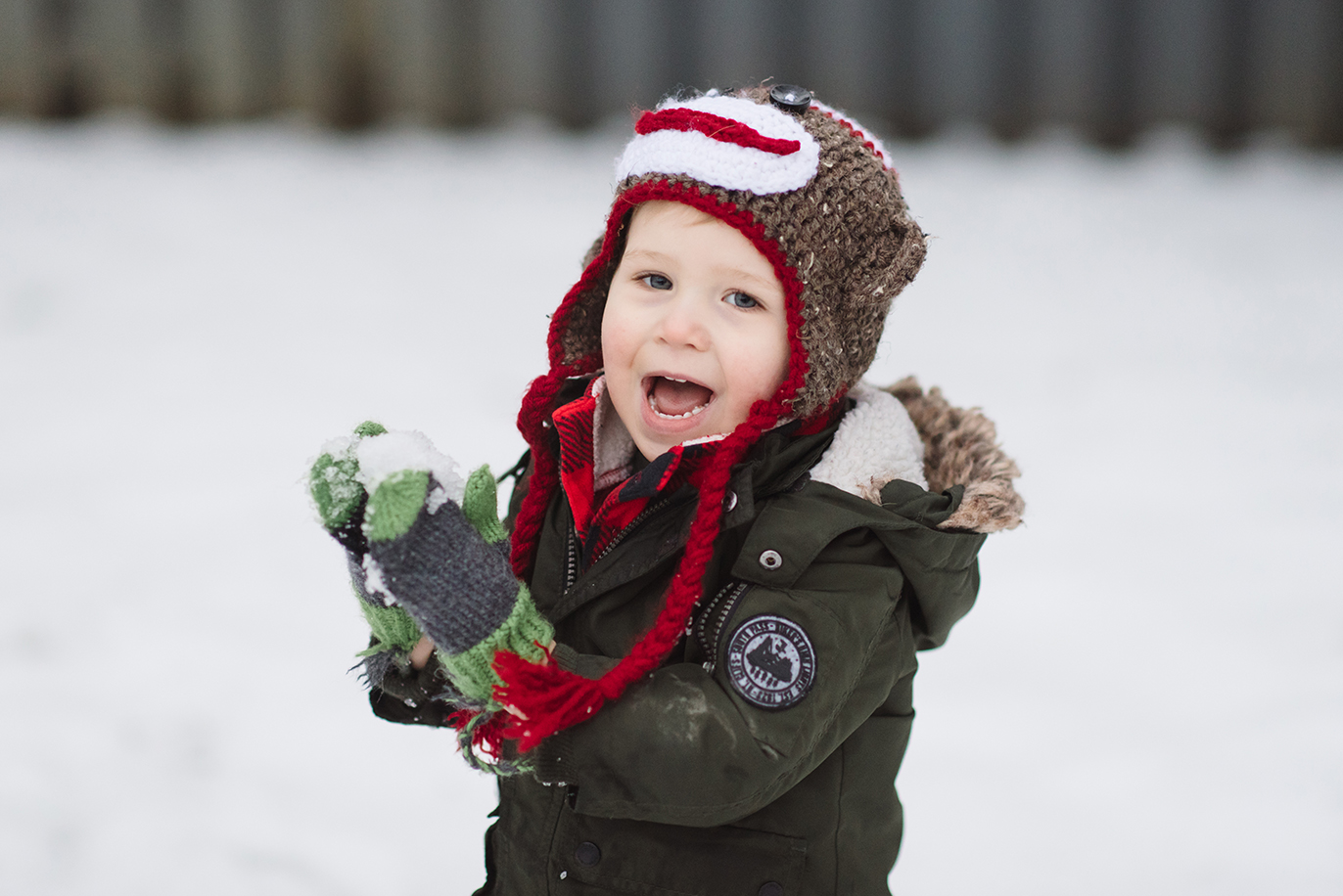 SMiling little boy playing in the snow