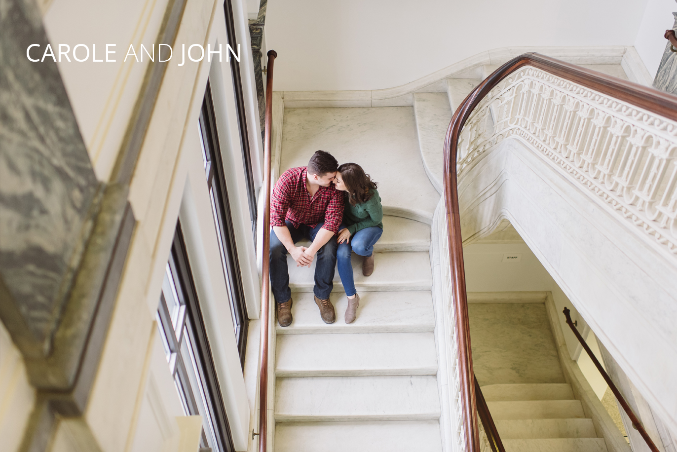 engaged couple hugging on stairs
