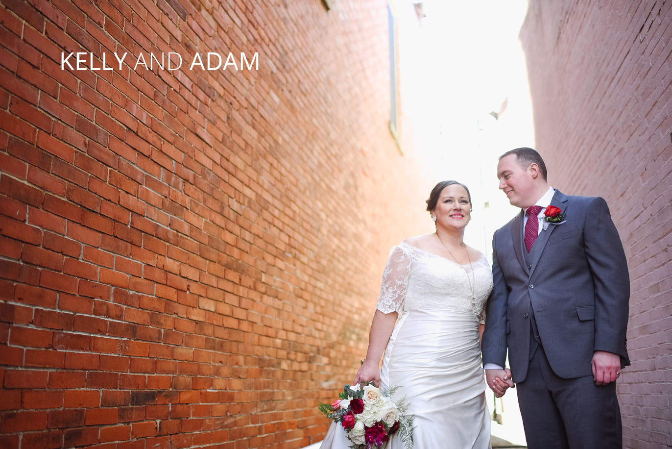 couple in rustic alley on their wedding day