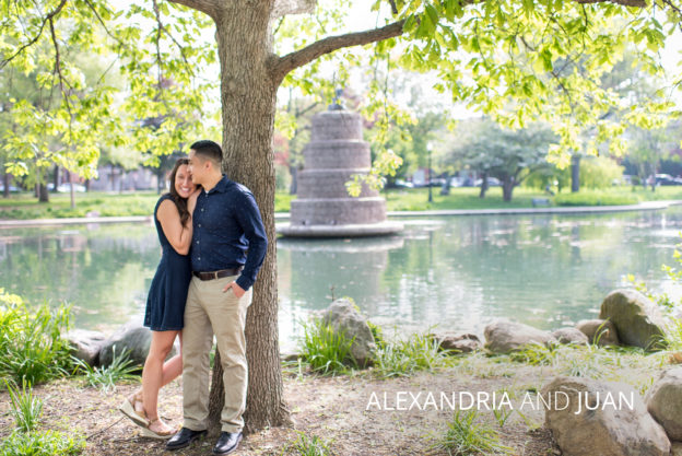 happy engaged couple under a tree