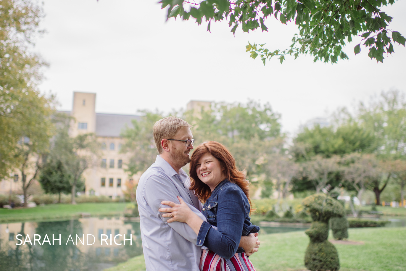 sarah and rich hugging in the topiary park