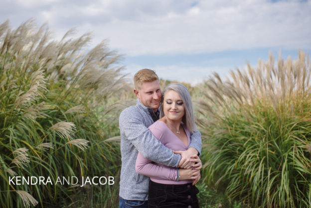 kendra and jacob hug on tartan field golf course
