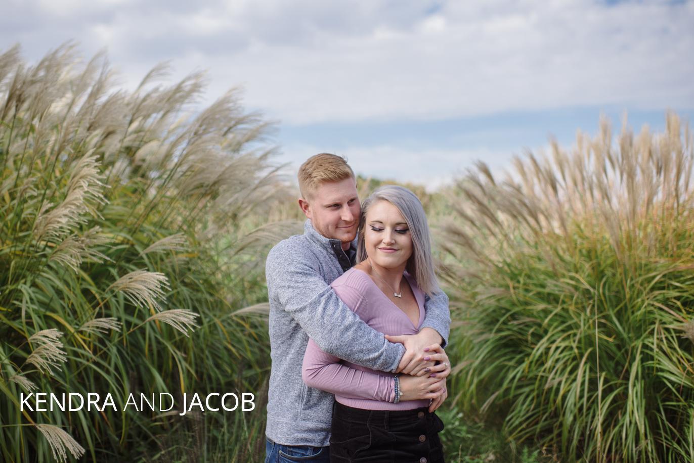 kendra and jacob hug on tartan field golf course