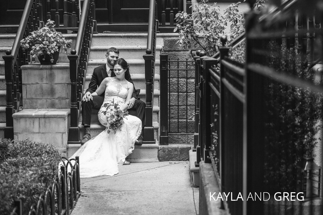 kayla and greg sit on a stoop in downtown columbus