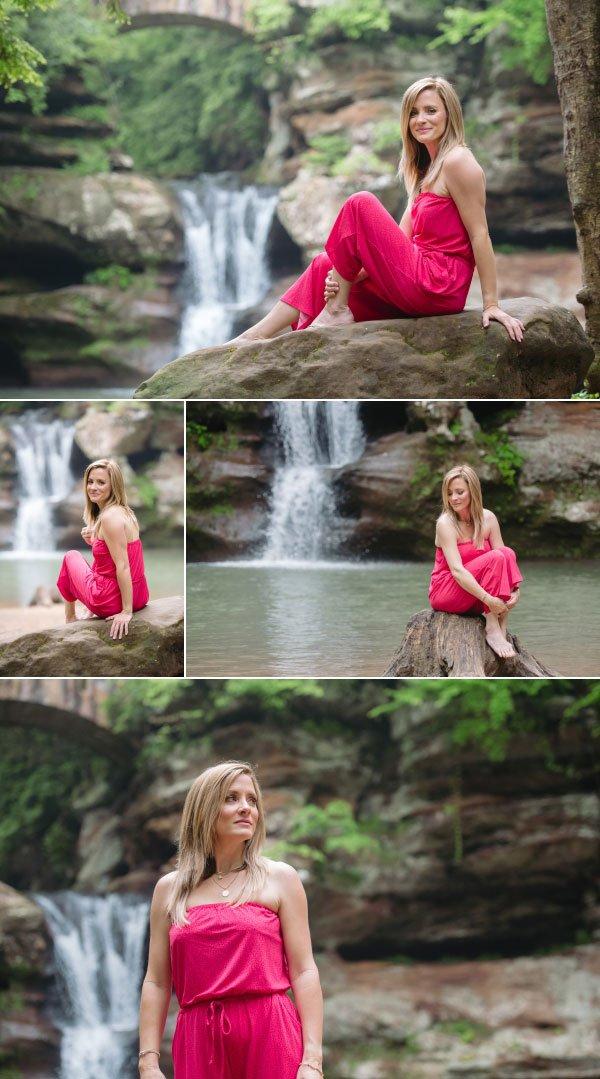 a woman sitting on a rock