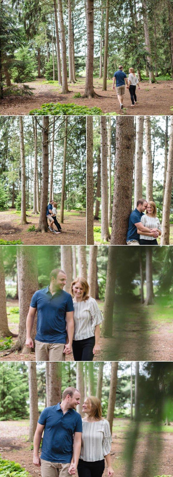 an engaged couple walking through inniswood gardens