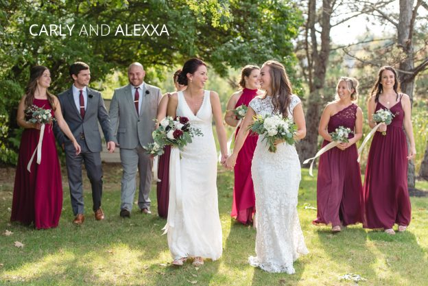 Carly and Alexxa walking on their wedding day