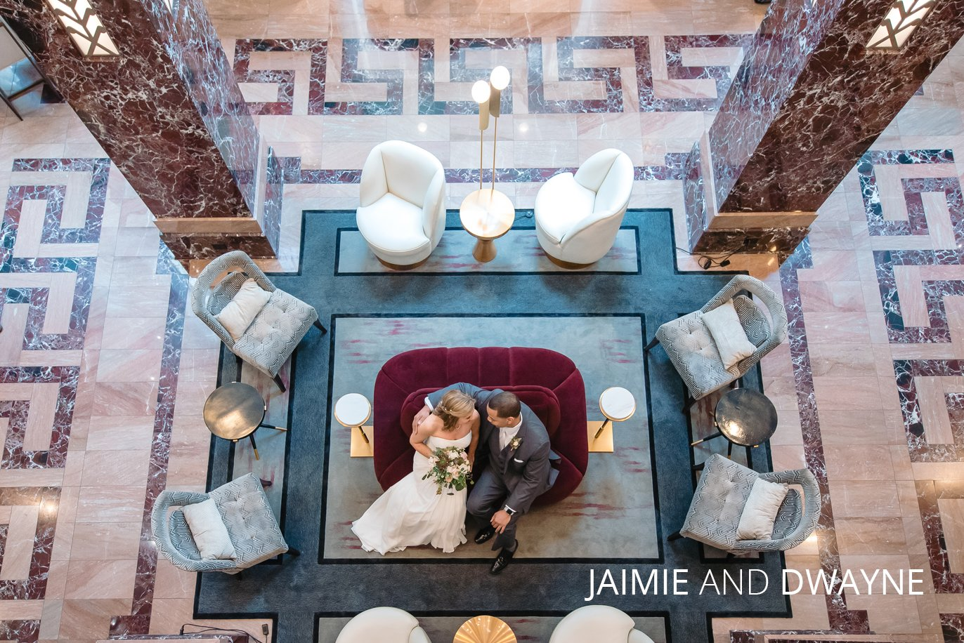 bride and groom in hotel lobby