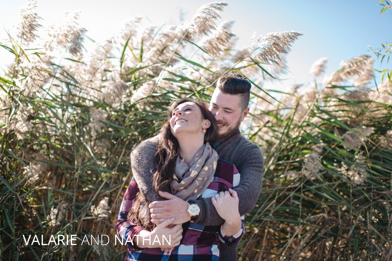 Valarie and Nathan hug in a field of tall grasses